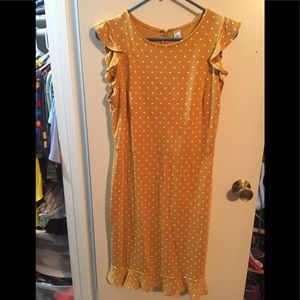 Mustard yellow size small dress.  Very cute style